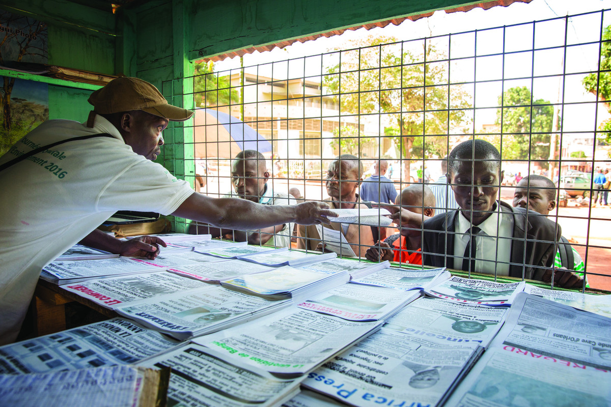 Selling newspapers in Central African Republic